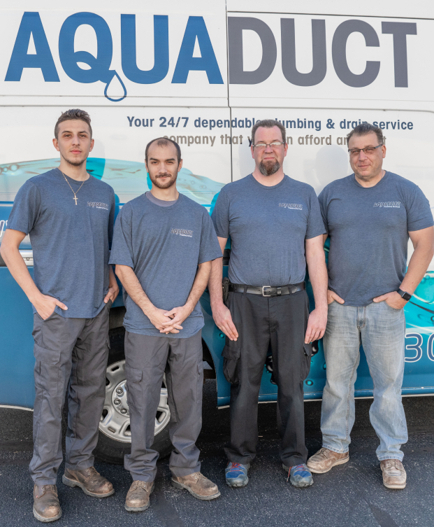 Staff in front of truck